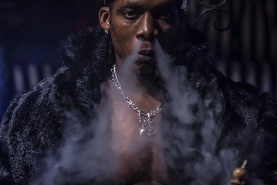 portrait,black man smokes hookah, detail, dark club atmosphere