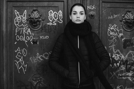 Woman Posing Against Big Old Door