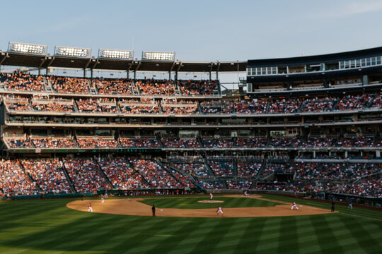 Baseball game and stadium with many fans