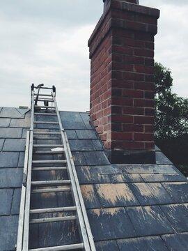 Ladders on a slate house roof
