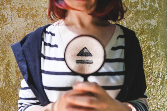 Woman with Magnifier Glass Showing Eject Symbol Tattoo on her Chest