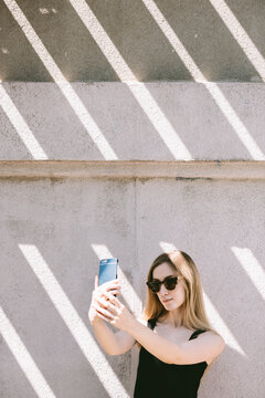 young woman taking a selfie with cell phone