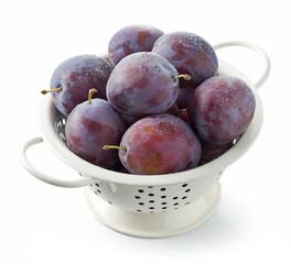 fresh ripe plums in colander