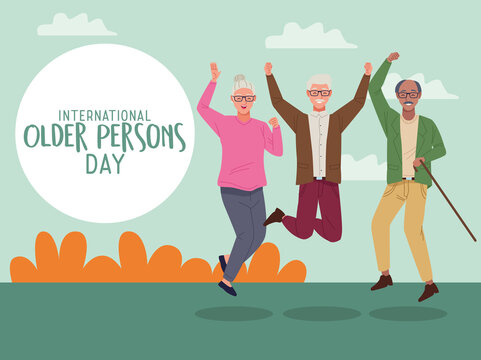 international older persons day lettering with old people jumping celebrating in the field