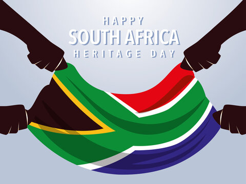 happy South African heritage day, hands holding flag of South Africa