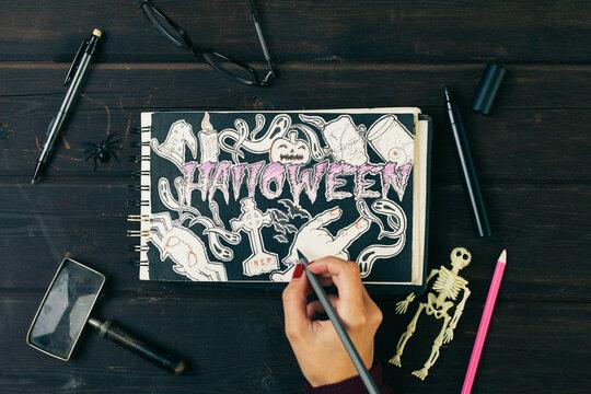Halloween draw in a sketchbook.
