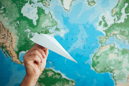 Paper Airplane with World Map
