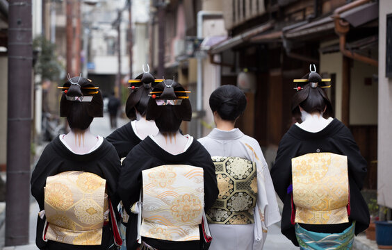 Traditional geisha and maiko out and about walking in Gion Kyoto Japan.