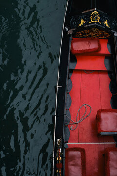 Close-up of Venitian gondola boat painted with red and black colors