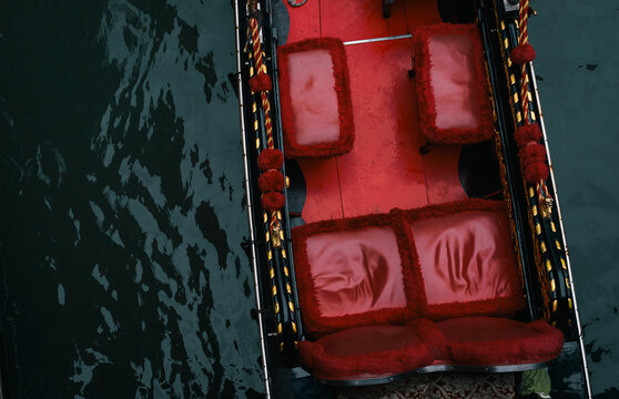 View on gondola boat with red seats floating on water