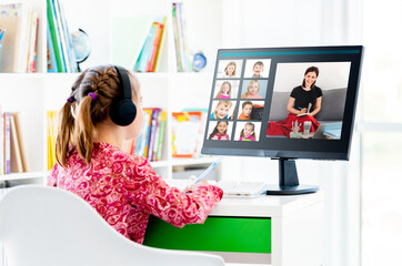 Little girl sitting at online lesson