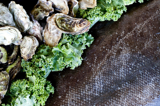 Clams oysters and halibut with kale