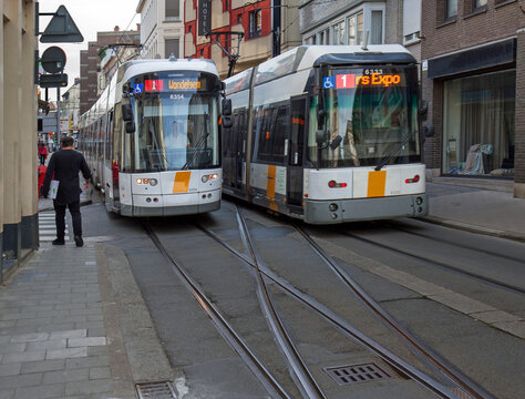 Ghent, Belgium: two trams block one of the narrow streets, Nederkouter, in the city centre.