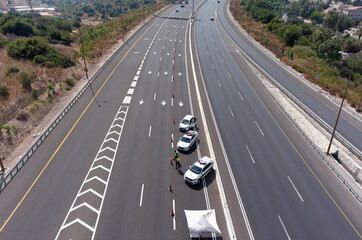 A drone picture of police cars set to imposes a second nationwide coronavirus disease (COVID-19) lockdown amid a rise in infections, on the road leading to Jerusalem at Hemed