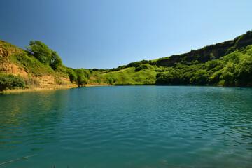 Panorama of a beautiful deep alpine karst lake