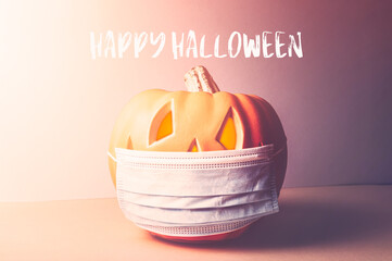 Happy Halloween 2020 text. New Normal and New reality concept. Orange Pumpkin or Halloween Jack o Lantern in medical protective mask, halloween and covid-19 concept