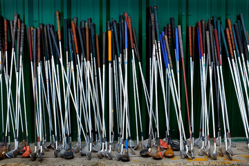 Row of Old Golf Clubs Sports