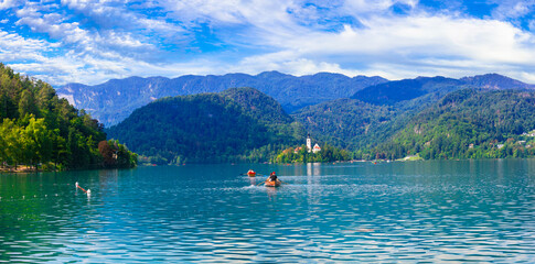 Idyllic nature scenery - beautiful magic lake Bled in Slovenia. Canoe acitivity. September 2019