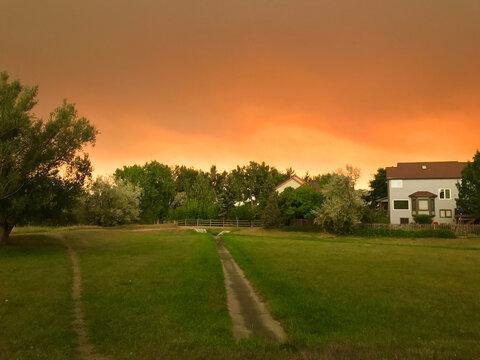 California, Oregon, Colorado wildfire orange smokey sky approaching neighborhood homes
