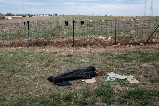 A migrant sleeps in a sleeping bag at One Stop Center for Migrants in Subotica