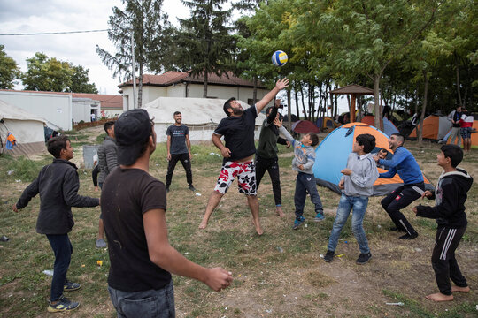 Migrants play volleyball at One Stop Center for Migrants in Subotica