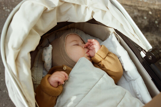 Baby sucking his finger while sleeping