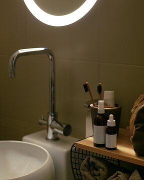 Still life of hygiene items in the bathroom near the mirror. Body and face care.