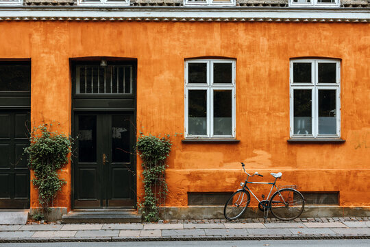 Bicycle against a colored wall in Copenhagen, Denmark