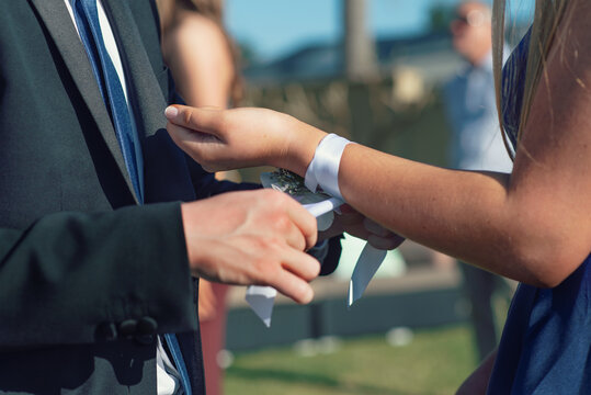 tying on the corsage