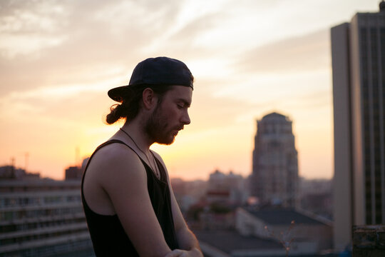 profile of a guy in a cap