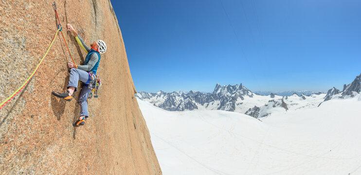 Man rock climbing on steep granite face