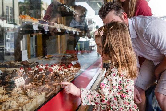 Cake shop window girl