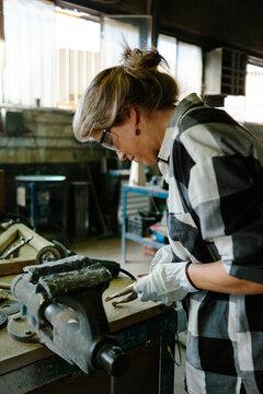 Sculptor working on a bronze workshop