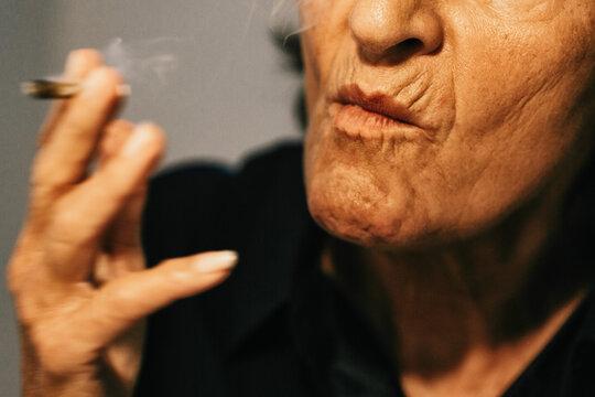 Close Up of Senior Woman Smoking CBD Joint