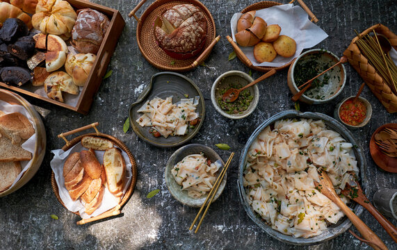 Delicious and rich food on a stone picnic table for outdoor picnics
