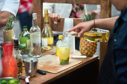 Bartender serving mojito cocktail