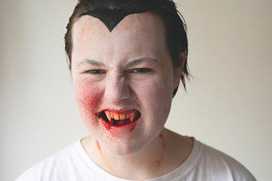Portrait of a teenage vampire at Halloween