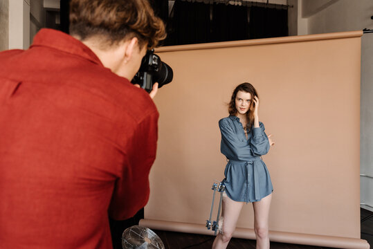Anonymous photographer taking pictures of model with fractured leg