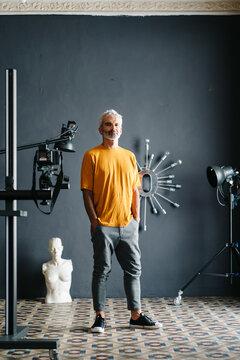 Confident artist in modern studio