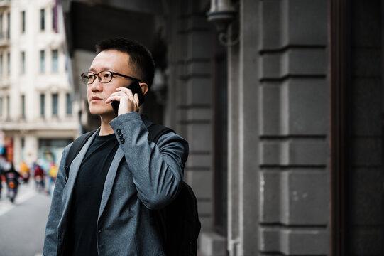 Portrait of businessman using cellphone