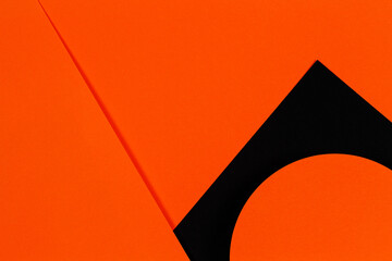 Abstract geometry paper texture background. Shape and lines in black and orange colors. Top view