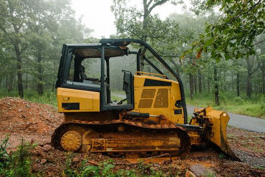 Buldozer in a misty forest