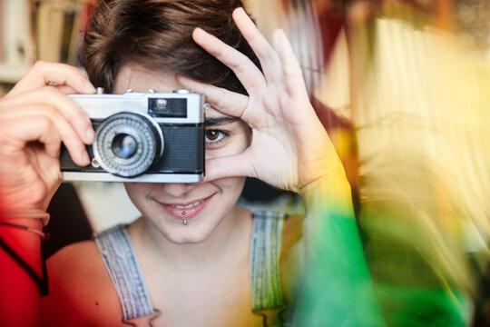 Smiling woman using photo camera