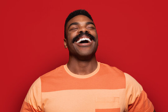 Happy african american man over red background