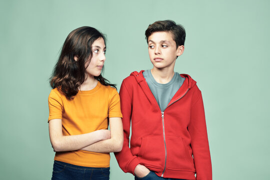 Teenage siblings in fight posture looking at each other