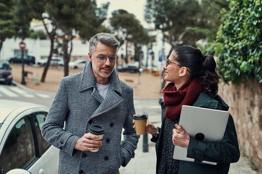 Coworkers talking on street during break