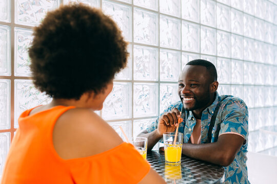 Cheerful African-American couple in cafe