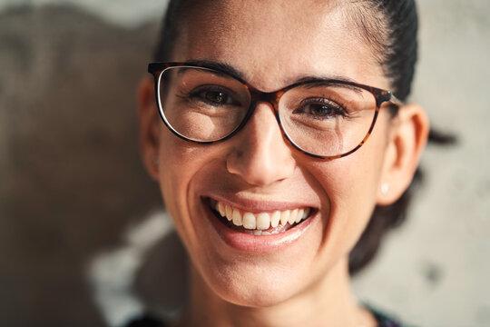 Portrait of laughing girl in eyeglasses