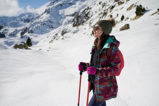 Happy girl hiking in winter