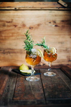 Rosemary gin fizz cocktail on wooden background